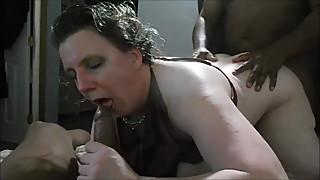 Older wife playing with two bbc in front of her hubby